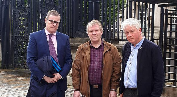 Director of the Pat Finucane Centre Paul O'Connor (right) with Robert Cunningham and solicitor Kevin Winters