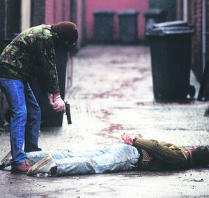 Punishment Attack: Kneecapping in an entry in belfast city centre. Picture posed