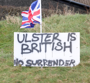 Protest: A loyalist sign and Union flag erected near Larne port