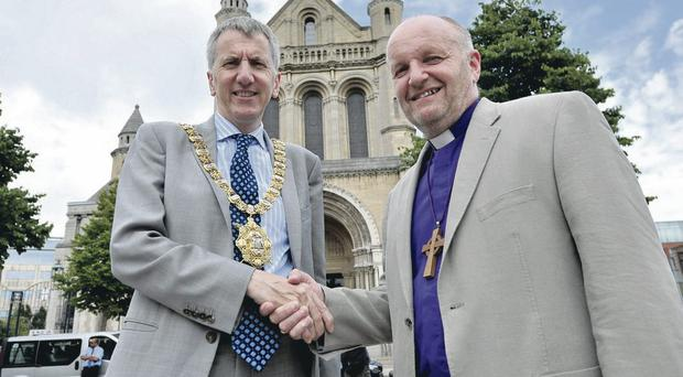 One for all: Lord Mayor Mairtin O Muilleoir with Bishop Alan Abernethy at St Anne's Cathedral