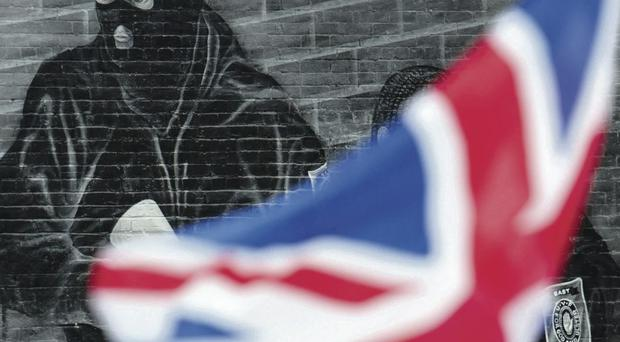 Divisive issue: Flags are being used to mark territory and reinforce sectarianism