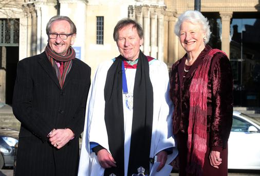 New beginnings: Dean John Mann at St Anne's in Belfast City Centre with George Jones (left) and Dame Mary Peters (right)