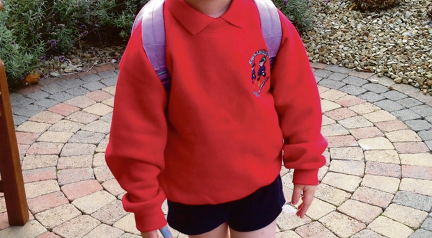 Big moment: little Katie spent ages finding the right hair clip to go with her bright red uniform