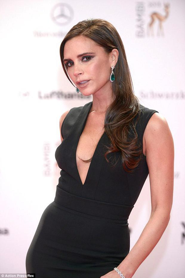 Pout time: Victoria Beckham rarely smiles on the red carpet