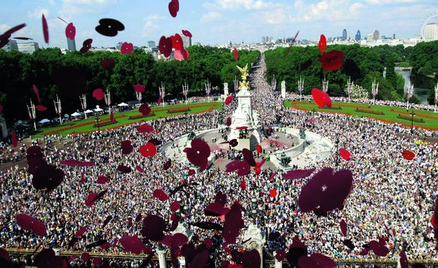 Poppies fall from the roof of Buckingham Palace Sunday July 10, 2005, at the end of a day of events marking the end of the War.
