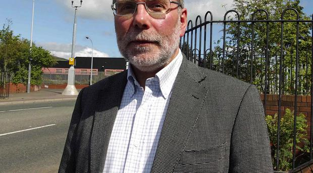 Furore: Housing Minister Nelson McCausland is feeling the heat at Stormont over the Red Sky controversy