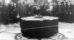 Sir Edward Carson signing the Ulster Covenant at Belfast City Hall