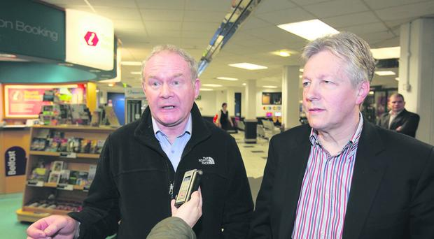 Needing assistance: Martin McGuinness and Peter Robinson return from the United States