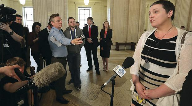 Ann Travers, whose sister Mary was shot dead by the IRA almost 30 years ago, speaks to the media at Stormont, Belfast as a bill barring ex-prisoners from becoming special advisers to ministers in Northern Ireland is likely to become law after the SDLP said they would not block it.