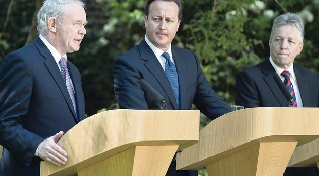 Prime Minister David Cameron with Northern Ireland's First Minister Peter Robinson and Deputy First Minister Martin McGuinness