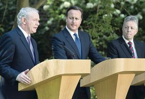 Prime Minister David Cameron with Northern Ireland's First Minister Peter Robinson and Deputy First Minister Martin McGuinness.