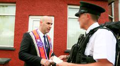 Orangeman Gerald Solinas hands over a letter of petition to PSNI at Woodvale