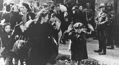 Nazi troops round up Jews