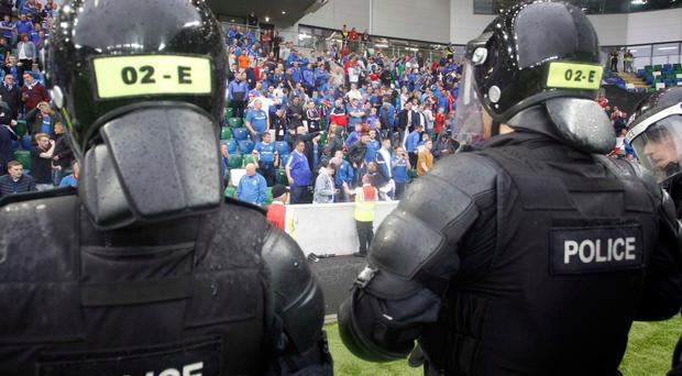 Riot police on the pitch at last Friday's Linfield v Celtic Champions League match at Windsor Park, Belfast