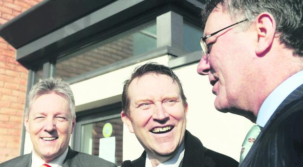 United front: Nesbitt and Robinson joke with unionist unity candidate Nigel Lutton