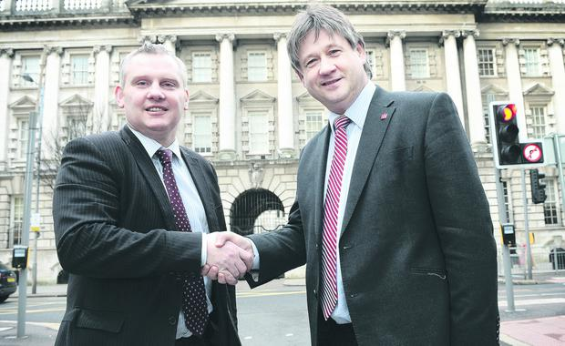 Two's company: John McCallister and Basil McCrea shake on their new party