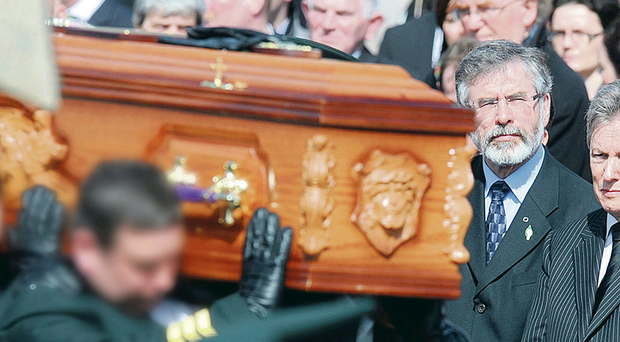 United stand: Peter Robinson and Gerry Adams at the funeral of Constable Ronan Kerr.