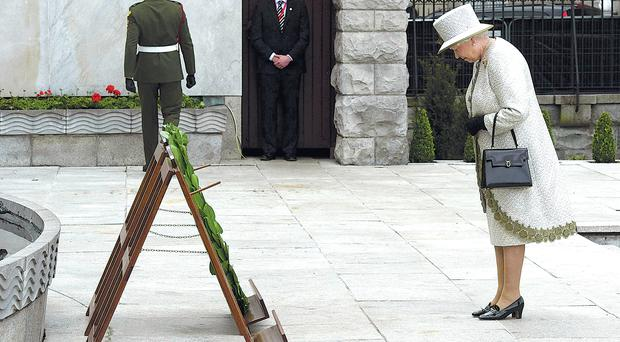 Symbolic gesture: The Queen bows her head at the Garden of Remembrance in Dublin, which honours those who died in the struggle for Irish independence from Britain