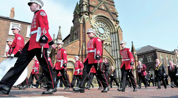 Apprentice Boys march peacefully past St Patrick's Church in Belfast last month