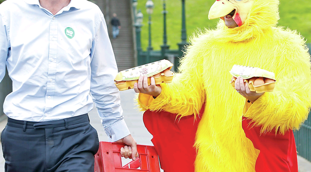 MP Jim Murphy, who was hit by an egg while campaigning last week, is pictured with a newspaper reporter dressed as a chicken, as he resumes his 100 Streets in 100 Days Better Together tour outside the Royal Scottish Academy in Edinburgh