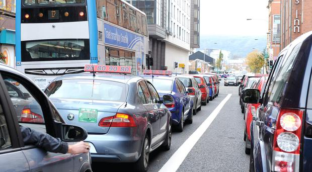 In a jam: Congested traffic in Belfast — but cars remain one of the most inefficient ways of using road space