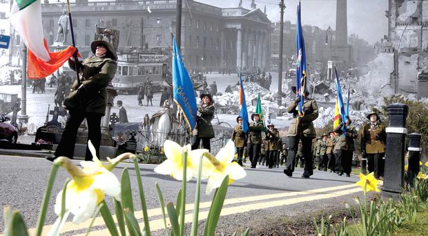 A 1916 Easter Rising Commemoration parades take place in Belfast and (background) Sackville Street in Dublin in the aftermath of the 1916 Rising