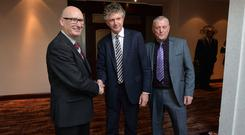 Tony Blair's former chief of staff Jonathan Powell (centre) with PUP leader Billy Hutchinson (left) and UDA chief Jackie McDonald after announcement of the new loyalist body