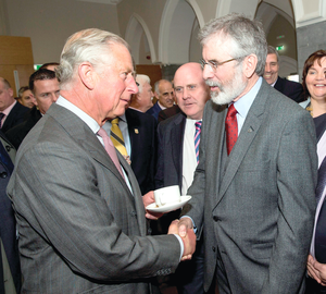 The Prince Of Wales shakes hands with Sinn Fein president Gerry Adams at the start of the four-day royal visit to Ireland