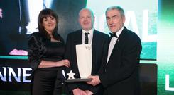 Anto Finnegan receives his award from Antoinette McKeown (chief executive of Sport NI) and Tyrone GAA manager Mickey Harte