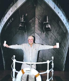 Clive Palmer in front of an artist impression of the Titanic ll