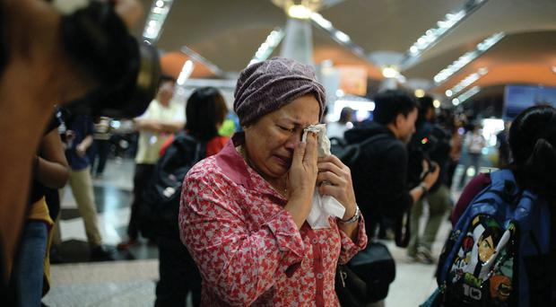 In shock: A woman reacts to news of the Flight MH17 disaster
