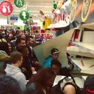 Desperate times: shoppers climb over each other on Black Friday