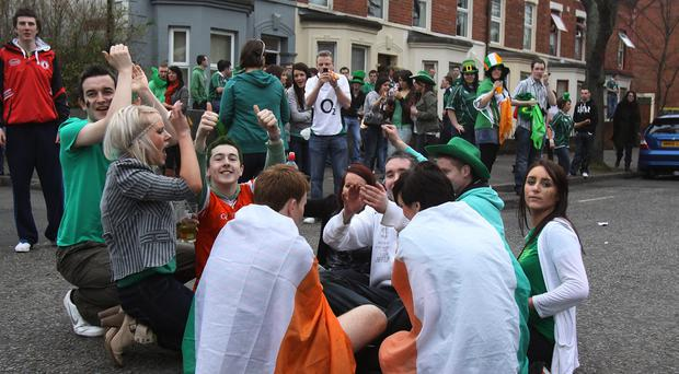 Street life: crowds in Belfast's Holylands on St Patrick's Day