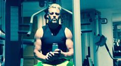 Darren Clarke poses for a snap in the gym