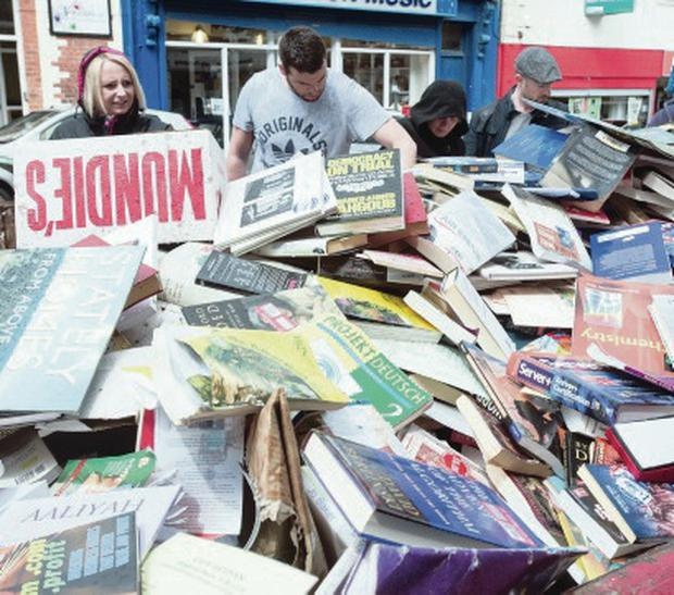 The discarded stock in the skip in Derry