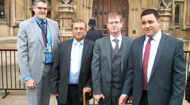 Jonathan Ganesh (far right) with (from left) Gavin Robinson MP, Ihsan Bashir and Protestant victims' campaigner Willie Frazer prior to a Parliamentary committee meeting