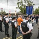 Protesters accompanied by a flute band paraded to police lines near Twaddell