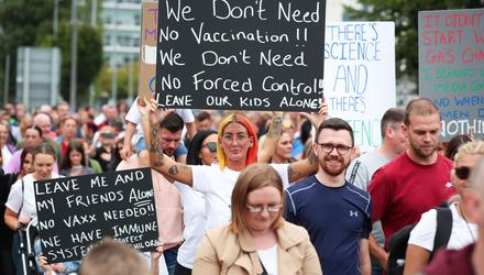 Stance: people protesting against the vaccine. Credit: Kelvin Boyes / Press Eye