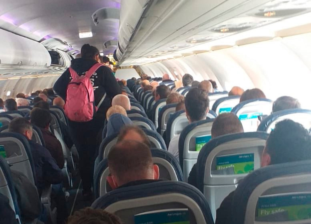 The packed Aer Lingus flight from Belfast to Heathrow didn't allow for social distancing