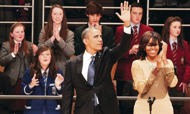 Celebrity status: Barack and Michelle Obama were afforded plenty of fanfare in Belfast