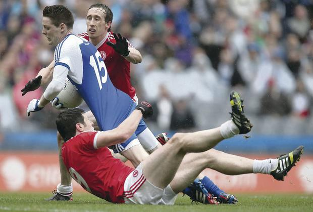 Getting shirty: Tyrone GAA player Sean Cavanagh fouls Conor McManus