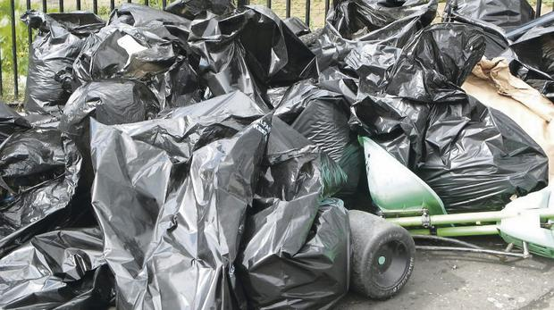 Waste disposal: discarded rubbish bags on the street