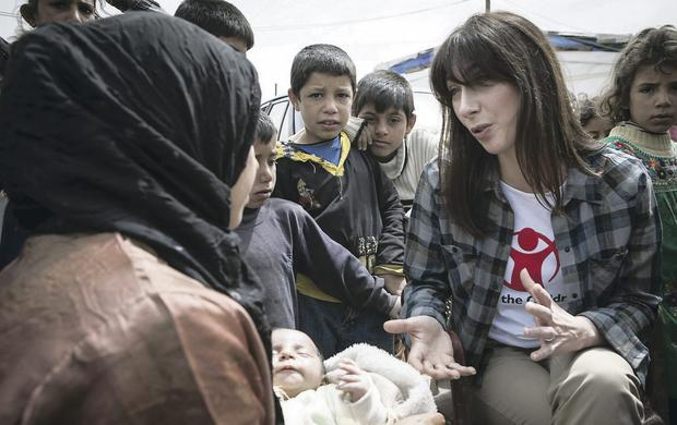 Samantha Cameron, pictured visiting a Syrian refugee camp, has stressed her mum credentials