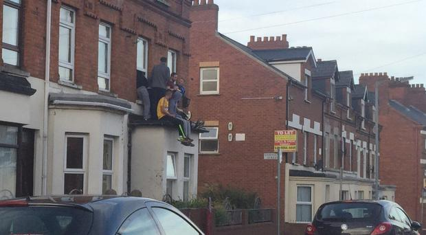 Unholy sight: students drinking outside a house in the Holylands