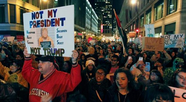 Protesters march on Wisconsin Avenue in Milwaukee to denounce the election of Donald Trump as US President