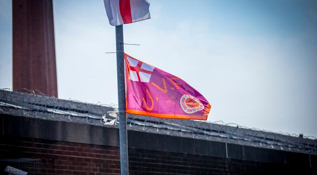 Paramilitary flags adorn many lamp posts across the city and beyond