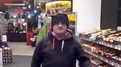 Barry McElduff poses with a loaf of bread on his head on the anniversary of the Kingsmill massacre