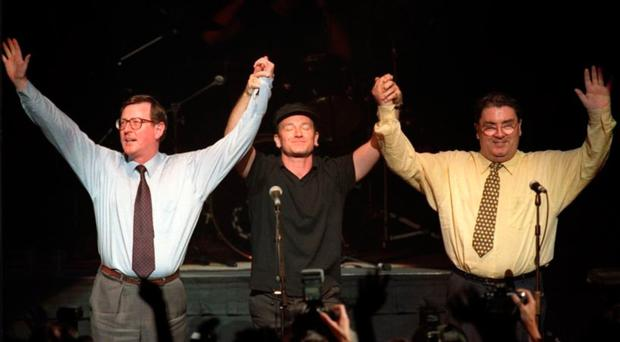 The sense of hope and reconciliation which saw Bono laud peacemakers David Trimble (left) and John Hume (right) has long since been replaced by cynicism and anger