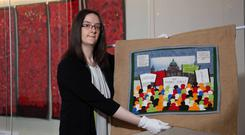 Karen Logan, project curator of National Museums NI, gets ready for the new exhibition