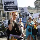 A pregnant woman attending a pro-abortion rally at Belfast City Hall